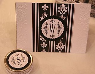 Closeup of Black and white invitation and favor