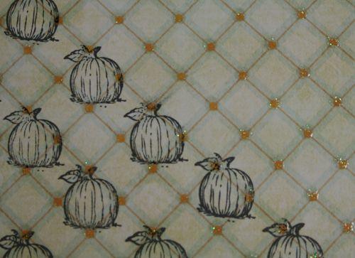Stampid images of pumpkin on grided design